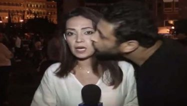 Lebanese protester kisses reporter while live on air